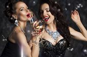 stock photo of christmas song  - Happy Laughing Women Drinking Champagne Singing Xmas Song - JPG