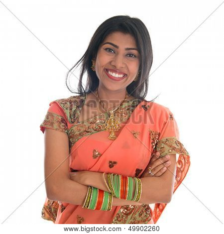 Portrait of beautiful traditional Indian woman in sari dress smiling, isolated over white background.