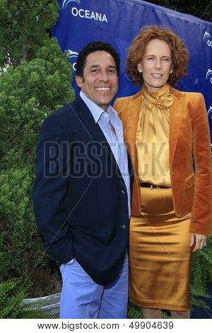 LOS ANGELES - AUG 18:  Oscar Nunez, Ursula Whittaker at the Oceana's 6th Annual SeaChange Summer Party at the Beverly Hilton Hotel on August 18, 2013 in Beverly Hills, CA