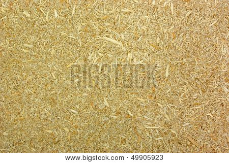 Particleboard - Wood shredded into tiny chips combined with adhesives  used as a substrate in construction and furniture industries