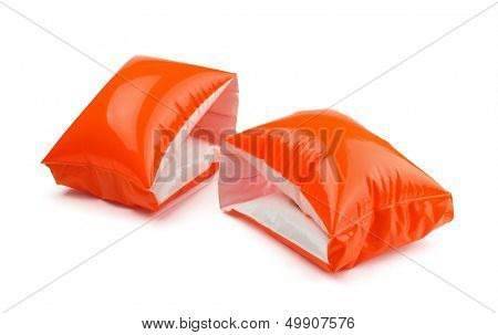 A pair of orange inflatable water armbands isolated on white
