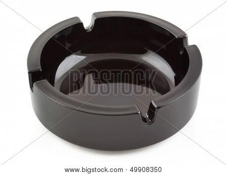 Empty black ceramic ashtray isolated on white