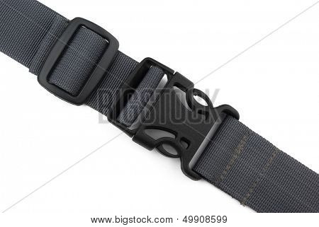 Locked black plastic buckle on strap isolated on white