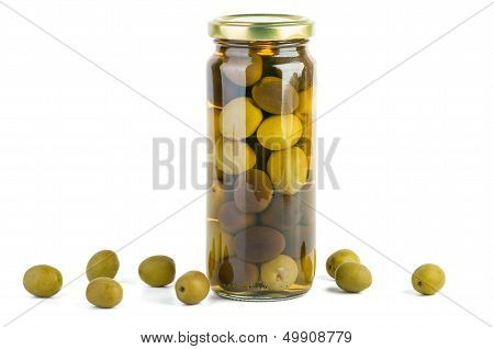 Glass jar with green and black olives . Some near