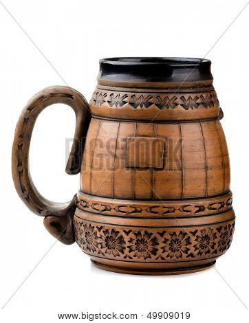 Old clay beer mug isolated on white