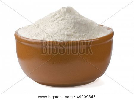 Bowl of fresh wheat flour isolated on white