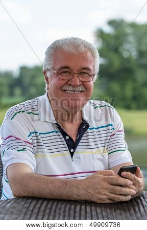 Senior Male Outside With His Phone