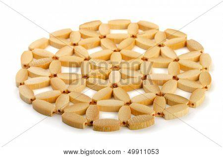 Round bamboo trivet isolated on white