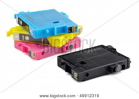 Four printer ink cartridges isolated on white