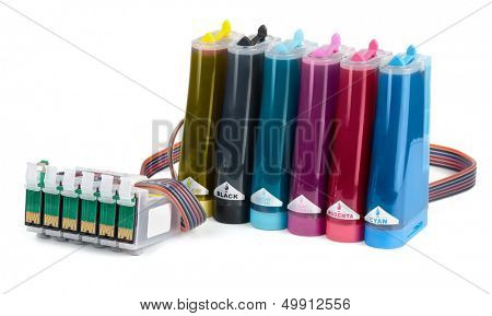 Cartridges and containers of continuous ink supply system isolated on white
