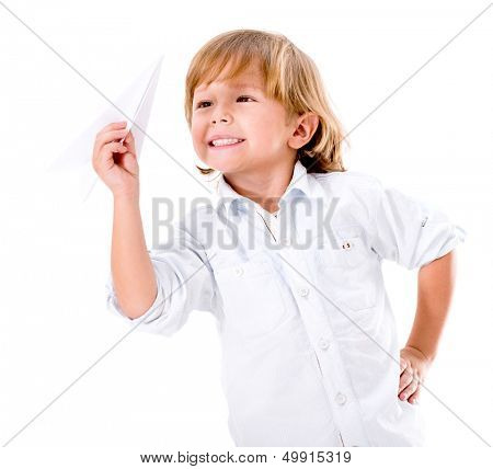 Happy boy playing with a paper plane - isolated over white background