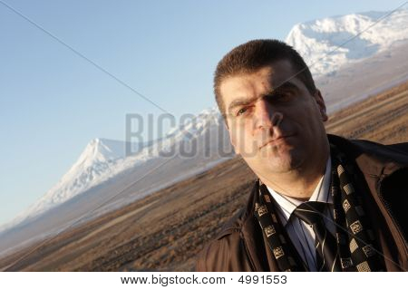 Man Poses On Mt. Ararat Background