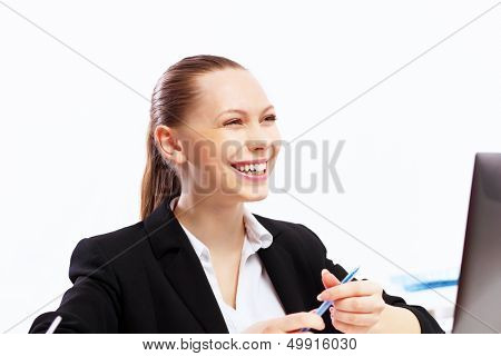 Business woman working on computer in office