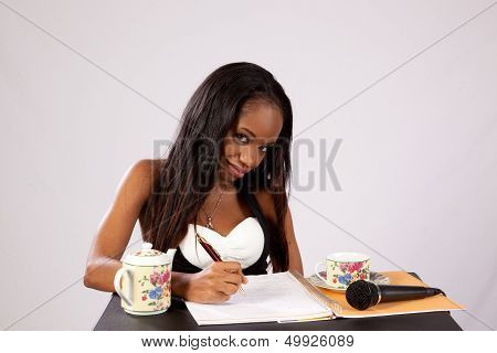 Black woman taking notes on music