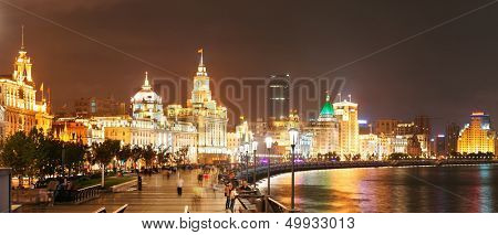 Shanghai Waitan night view with historic buildings over Huangpu River panorama