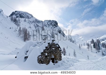 Mountain hut - shelter for mountaneers from the snow storm in winter