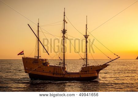 Medieval Sailing Ship In Sunset