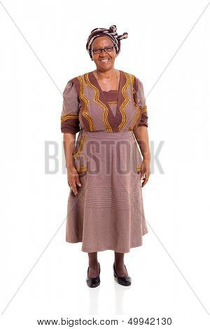 happy elderly african woman in traditional attire standing on white background