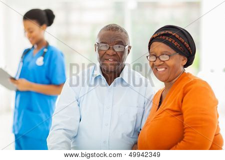 happy senior african couple in doctors office