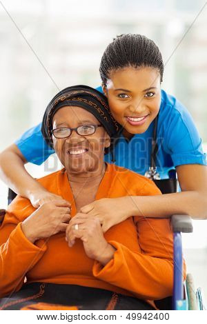 portrait of senior african disabled woman and her caregiver