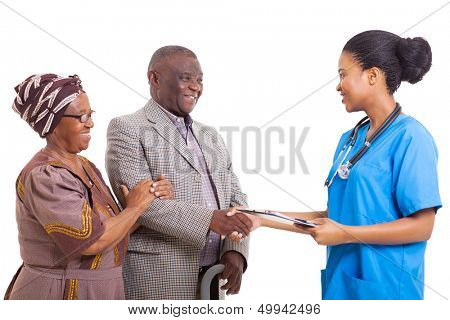 friendly african nurse hand shake with senior patient and wife on white background