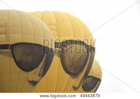 Barneveld, The Netherlands - 22 August 2013: Yellow Face Balloons Taking Off At International Balloo