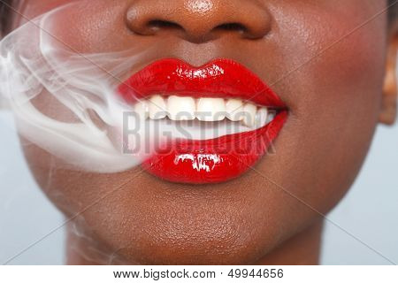 Lips of a Woman With Cigarette Smoke