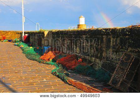 Fishing Nets Under A Rainbow.
