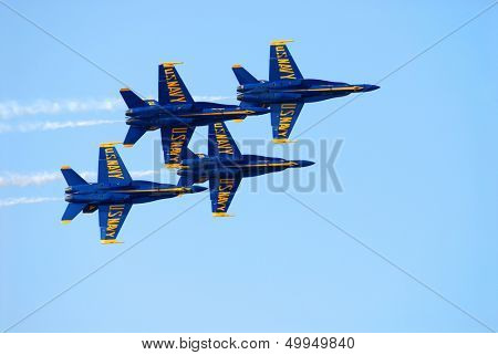Four Navy Blue Angel FA-18 Hornets in flight during an air show