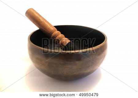 Singing bowl with wooden stick
