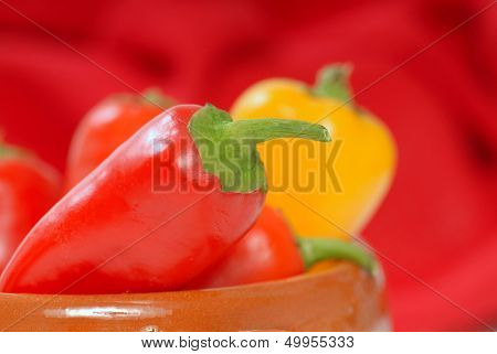 Delicious variety of red, yellow and orange chili peppers.