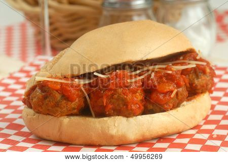 Delicious meatball sandwich with marinara sauce, cheese and wine.