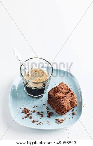 Chocolate Brownie On Plate Served With Espresso Shot
