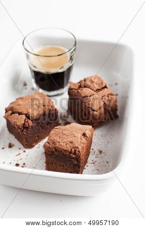 Chocolate Brownies On Plate Served With Espresso Shot