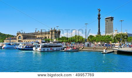 BARCELONA, SPAIN - AUGUST 16: Port Vell and Columbus Monument on August 16, 2012 in Barcelona, Spain. It is a 60 meters tall monument for Christopher Columbus at the lower end of La Rambla