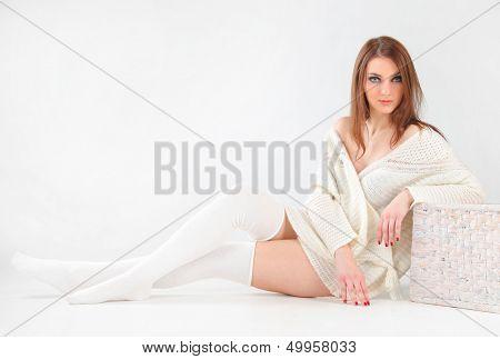 cute woman wearing white sweater