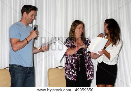 LOS ANGELES - AUG 25:  Daniel Goddard, Fan, Christel Khalil; doing a scene from a YnR script at the Goddard and Khalil Fan Event at the Universal Sheraton Hotel on August 25, 2013 in Los Angeles, CA