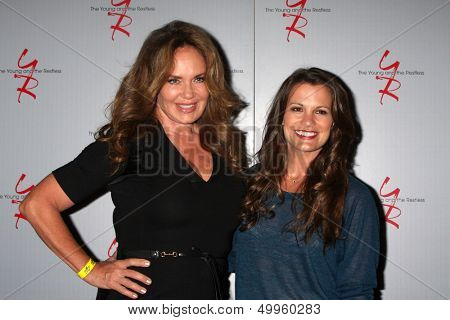 LOS ANGELES - AUG 24:  Catherine Bach, Melissa Claire Egan at the Young & Restless Fan Club Dinner at the Universal Sheraton Hotel on August 24, 2013 in Los Angeles, CA