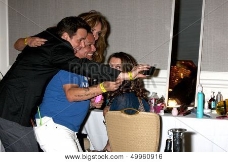 LOS ANGELES - AUG 24:  Christian LeBlanc, Catherine Bach, George Guzman, Melissa Claire Egan at the YnR Fan Dinner at the Universal Sheraton on August 24, 2013 in Los Angeles, CA