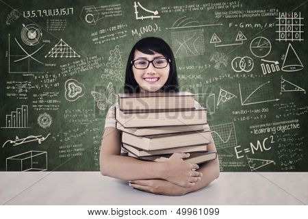 College Student With Books In Class