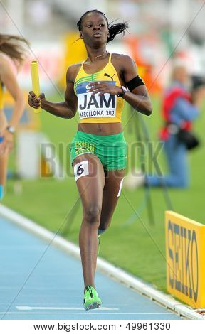BARCELONA - JULY, 14: Shericka Jackson of Jamaica competes on 4X400 Relay of the 20th World Junior Athletics Championships at the Olympic Stadium on July 14, 2012 in Barcelona, Spain