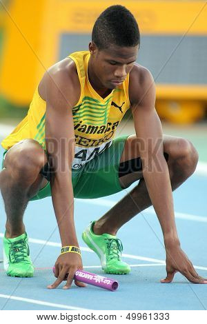 BARCELONA - JULY, 14: Shavon Barnes of Jamaica competes on 4X400 Relay of the 20th World Junior Athletics Championships at the Olympic Stadium on July 14, 2012 in Barcelona, Spain
