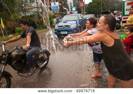 THAILAND - APR 14: People celebrated Songkran Festival, on 14 Apr 2013 on Ko Chang, Thailand. Songkran is celebrated in Thailand as the traditional New Year's Day from 13 to 16 April.