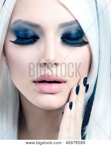 Beauty Fashion Girl black and white style. Smoky Eyes Make up, False Eyelashes and Long White Hair with Black Stripes. Smokey Eyes Makeup. Black Nails. High Key Portrait. Winter Holiday Makeover