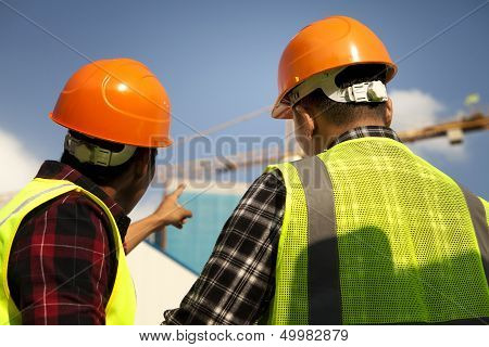 Construction Worker Pointing Yellow Crane