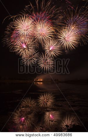 Bursts Of Orange And Pink Fireworks