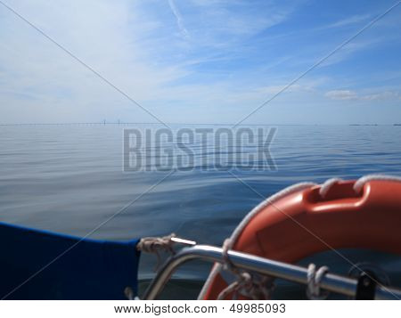 Rescue Red Lifebuoy On Sail And Blue Sky Sea