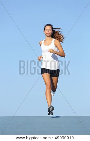 Front View Of A Beautiful Sportswoman Running Towards Camera