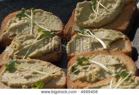Fresh Pea Hummus Crostini With Pea Tendril Garnish