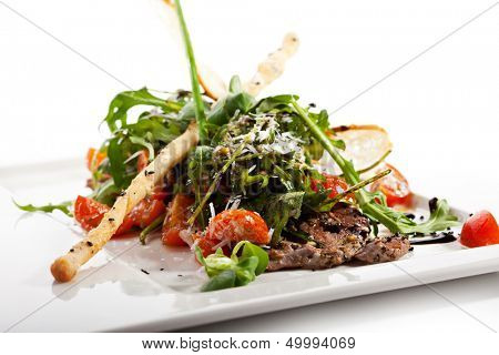 Italian Salad with Fried Beef, Lettuce, Cherry Tomatoes and Parmesan Cheese